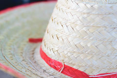 Texture woven tan straw hat detail. The texture woven tan straw hat detail royalty free stock photos
