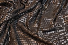 Black sequined fabric. Texture of a wrinkled black sequined fabric royalty free stock photos