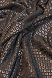 Sequined black fabric. Texture of a wrinkled black sequined fabric royalty free stock image