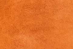 Texture of wrong side genuine leather close-up, cowhide, orange. For natural, artisan backgrounds, substrate composition. Texture of genuine leather close-up Stock Images
