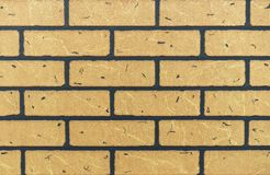 Texture of yellow brick wall for background stock photo
