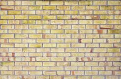Yellow brick wall, backgroud and texture. Brick masonry horizontal color technology architecture wallpaper. Texture of a yellow brick wall background in the royalty free stock photos