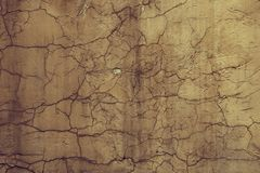Texture yellow cement wall with cracks Stock Images