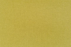 Texture of the yellow color linen fabric. Close-up view for the Royalty Free Stock Photos