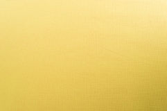 Texture of yellow cotton fabric as abstract background. Linen texture fabrics, waffle structure Royalty Free Stock Photo