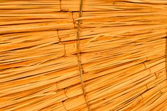 Yellow dry corrugated ribbed convex volumetric straw, hay with long branches and sloping slopes. The background. Texture yellow dry corrugated ribbed convex stock photo