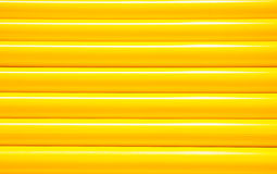 Texture yellow iron pipe Royalty Free Stock Image