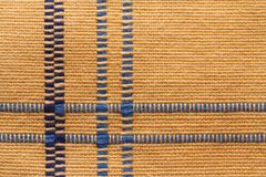 Texture of yellow linen natural fabric with blue stripes. Stock Image