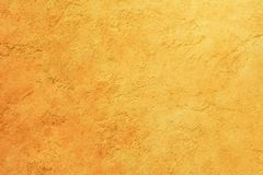 Texture of yellow orange cement wall Stock Images
