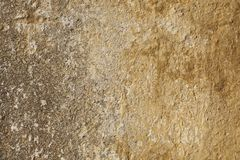 Texture of the yellow plaster on the wall Stock Photos