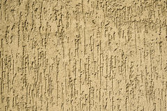Texture of yellow plaster wall Stock Image
