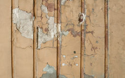 Texture of yellow plastered wall with vertical relief Stock Photography