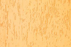 Texture of a yellow putty wall. Yellow roughened bumpy texture background.yellow pattern royalty free stock images