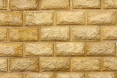 Texture - yellow stone wall stock images