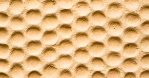 Texture of yellow wall in form of honeycombs Royalty Free Stock Photo
