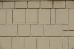 Texture of a yellow wall with rectangular tiles Royalty Free Stock Photos