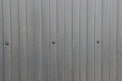 Texture of zinc covered wave-shaped steel sheet. With screws in it Royalty Free Stock Images