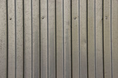 Texture of zinc covered wave-shaped steel sheet. With screws in it Royalty Free Stock Photography