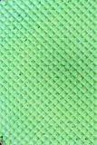Textured abstract background. Colourfull green waffle. Close up. Flat lay Stock Images