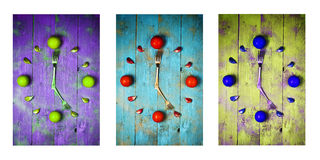 Textured abstract clock face showing 5 on wooden background,clocks icons, triptych in purple,green and blue Stock Photo