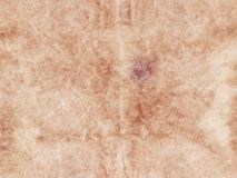 textured abstract old paper sheet beige background. copy space. vintage parchment stock photo