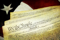 Textured American Constitution with US Flag. Textured American Constitution lying over top of the US flag Stock Photo