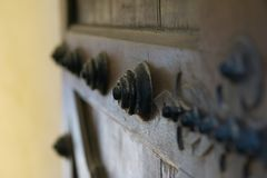 Textured backdrop, Old wooden door from medieval era. royalty free stock images