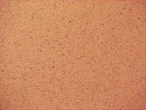 Textured Background. Pink speckled background texture with dark spots royalty free stock photo