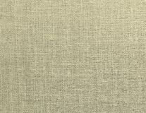 Textured background of beige natural textile. The textured background of beige natural textile for text, banner, poster, label, sticker, layout, wallpaper royalty free stock photography