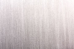 Textured background of brushed grey industrial metal plate Stock Photography