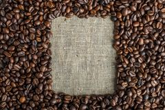 Textured background of coffee beans in the shape of a square frame top view. Concept love for a fresh and fragrant drink. Textured background of coffee beans in stock image