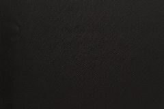 Textured background of fabric black color. The textured background of fabric or textile material of black color Royalty Free Stock Photo