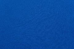 Textured background fabric of blue color Royalty Free Stock Image