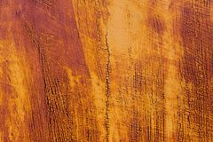 Textured background of a faded yellow paint with rusted cracks on rusted metal. Grunge texture of an old cracked metal. Textured background of a faded yellow Stock Photos