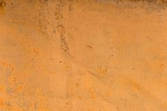 Textured background of a faded yellow paint with rusted cracks on rusted metal. Grunge texture of an old cracked metal. Textured background of a faded yellow Stock Photography