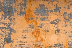 Textured background of a faded yellow paint with rusted cracks on rusted metal. Grunge texture of an old cracked metal. Textured background of a faded yellow Stock Photo