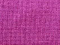 Textured background of fuchsia natural textile. The textured background of fuchsia natural textile for text, banner, poster, layout, wallpaper royalty free stock photos