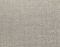 Textured background of gray natural textile. The Textured background of gray natural textile for text, banner, logo, poster, label, sticker, layout, wallpaper stock images