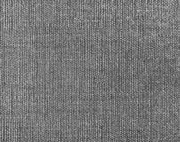 Textured background of gray natural textile. The Textured background of gray natural textile for text, banner, logo, poster, label, sticker, layout, wallpaper stock photography