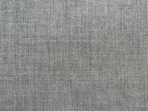 Textured background of gray natural textile. The Textured background of gray natural textile for text, banner, logo, poster, label, sticker, layout, wallpaper royalty free illustration