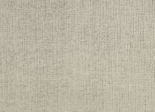Textured background of gray natural textile. The textured background of gray natural textile for text, banner, poster, label, sticker, layout, wallpaper, fabric royalty free stock images