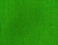 Textured background of green natural textile. The Textured background of green natural textile for text, banner, logo, poster, label, sticker, layout, wallpaper royalty free stock photo