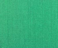 Textured background of green natural textile. The Textured background of green natural textile for text, banner, logo, poster, label, sticker, layout, wallpaper royalty free stock photography