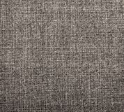 Textured background of grey natural textile. The background of textured grey natural textile for text, banner, poster, layout, wallpaper royalty free stock image