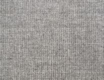 Textured background of grey natural textile. The background of textured grey natural textile for text, banner, poster, layout, wallpaper stock images
