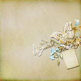 Textured background  with illustration. Paper butterfly , box, flowers and a tag Royalty Free Stock Photography