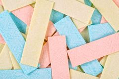 Textured background many chewing gum plates. Textured background made out of many chewing gum plates stock photo