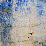 Textured background of the old wall with traces of blue paint Royalty Free Stock Photo