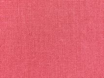 Textured background of pink natural textile. The Textured background of pink natural textile for text, banner, logo, poster, label, sticker, layout, wallpaper royalty free stock photography