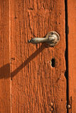 Textured background of red wooden door Royalty Free Stock Image